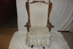 upholstered swivel rocker before